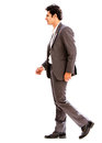 Business man walking to side isolated over white background Stock Photography