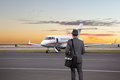 Business man walking toward a private jet Royalty Free Stock Photo