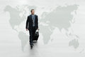 Business man walking the world map, international travel concept Royalty Free Stock Photo