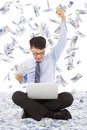 Business man watching laptop and raising a hand with money rain Royalty Free Stock Images