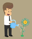 Business man watering flowers, investing money flowers