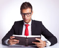 Business man wearing glasses reading a book Stock Image