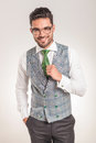 Business man wearing white shirt, grey vest and green tie. Royalty Free Stock Photo