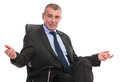 Business man welcomes you from his chair welcoming with arms open while sitting on on a white background Stock Photo