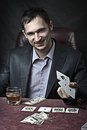 Business man winner playing poker Stock Photo
