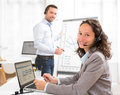 Business man and woman analysing stats while doing video confere Royalty Free Stock Photo