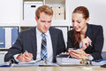 Business man and woman in office men women having a meeting the Royalty Free Stock Photo