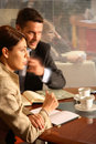Business man and woman talking in the office Royalty Free Stock Photography