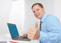 Business man working on his laptop Stock Photography