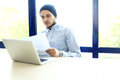Business man working at office with laptop and documents on his desk Royalty Free Stock Photo