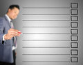 Business man writing on blank checklist Royalty Free Stock Photo