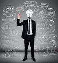 Business man writing business plan bulb head Stock Photography