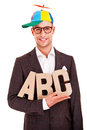 Business man writing coaching concept abc bussiness letters and funny hat Royalty Free Stock Photography