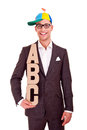 Business man writing training concept abc bussiness coaching letters and funny hat Royalty Free Stock Image