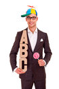 Business man writing training concept abc bussiness coaching letters and funny hat lollipop Stock Photos