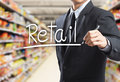 Business man writing word retail in the supermarket Stock Images