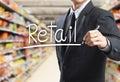 Business man writing word retail Royalty Free Stock Photo