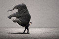 Business manager carry elephant on grey - leadership concept Royalty Free Stock Photo
