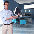 Business manual man showing a book in an office interior Royalty Free Stock Images