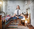 Business meditation businessman with long hair doing in old russian house with traditional stove Stock Photography