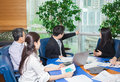 Business meeting asian nationality people sitting for table with plan on high floor in the office male and woman Royalty Free Stock Image