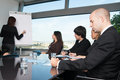 Business meeting in board room with skyline people talking during Royalty Free Stock Photography