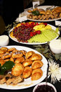 Business meeting breakfast party buffet a catered tabletop of fresh fruits rolls cheese and breads for a hotel Royalty Free Stock Photography
