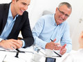 Business meeting - Happy businesspeople talking Royalty Free Stock Photography