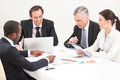 Business meeting team of people mixed ages diverse management Stock Image