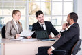 Business meeting. Three successful business people sitting in th Royalty Free Stock Photo