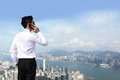 Business men call by smart phone happy man on architecture background asia hong kong Stock Photos