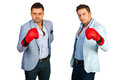 Business men in competition wearing boxing gloves and being Royalty Free Stock Image