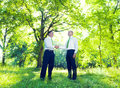 Business men handshaking in Garden Royalty Free Stock Photo