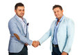 Business men shaking hands their isolated on white background Stock Photos