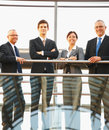 Business men and woman standing together in a line Stock Photo