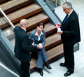 Business men and woman talking together Royalty Free Stock Photos
