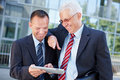 Business men working on tablet Royalty Free Stock Photos