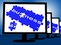 Business on monitors shows corporation transactions and partnership Royalty Free Stock Photography