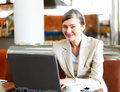 Business on the move - woman using laptop Royalty Free Stock Image
