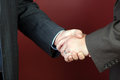 Business negotiations illustrated with a close up of a handshake between two men Stock Photo