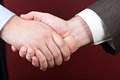 Business negotiations illustrated with a close up of a handshake between two men Royalty Free Stock Photos