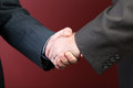 Business negotiations illustrated with a close up of a handshake between two men Royalty Free Stock Photography