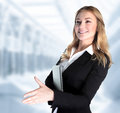 Business partner closeup portrait of cute girl holding laptop and stretches out her hand for a handshake with make a deal concept Royalty Free Stock Photography