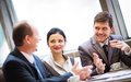 Business partners communicating at meeting portrait of smart Royalty Free Stock Images