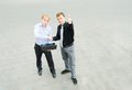 A business partners concluded a bargain on the street image of concluding and standing Stock Image