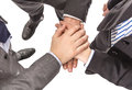 Business partners with hands above showing power and unity closeup of on top of each other in a teamwork Stock Photo