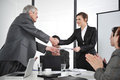 Business partners handshaking at meeting and receiving applause Stock Photography