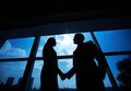 Business partners handshaking outlines of successful businessman and businesswoman after striking deal Royalty Free Stock Photography