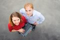 A business partners looking at the camera on the street image of and using laptop focus is made top of gray background of Royalty Free Stock Image
