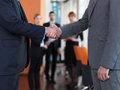 Business partners partnership concept with two businessman handshake Royalty Free Stock Photography